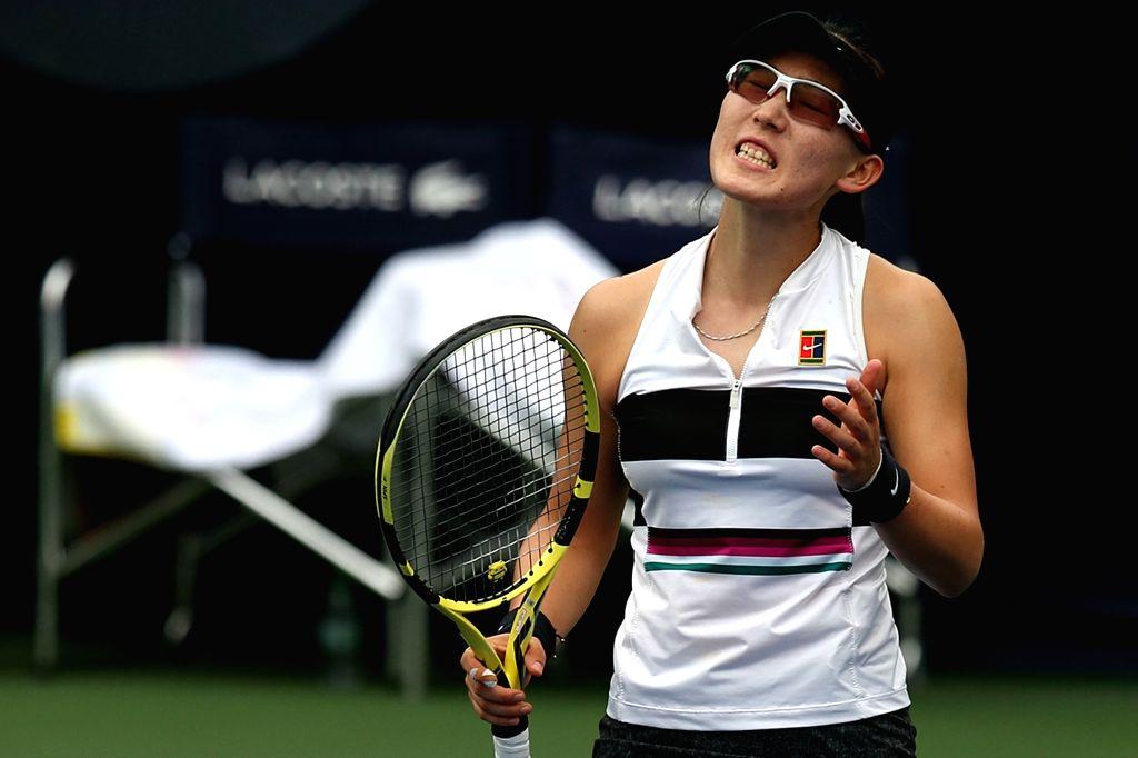 DUBAI, Feb. 19, 2019 - Zheng Saisai reacts during the women's singles second round match between Garbine Muguruza of Spain and Zheng Saisai of China at Dubai Duty Free Tennis WTA Championships 2019 ...
