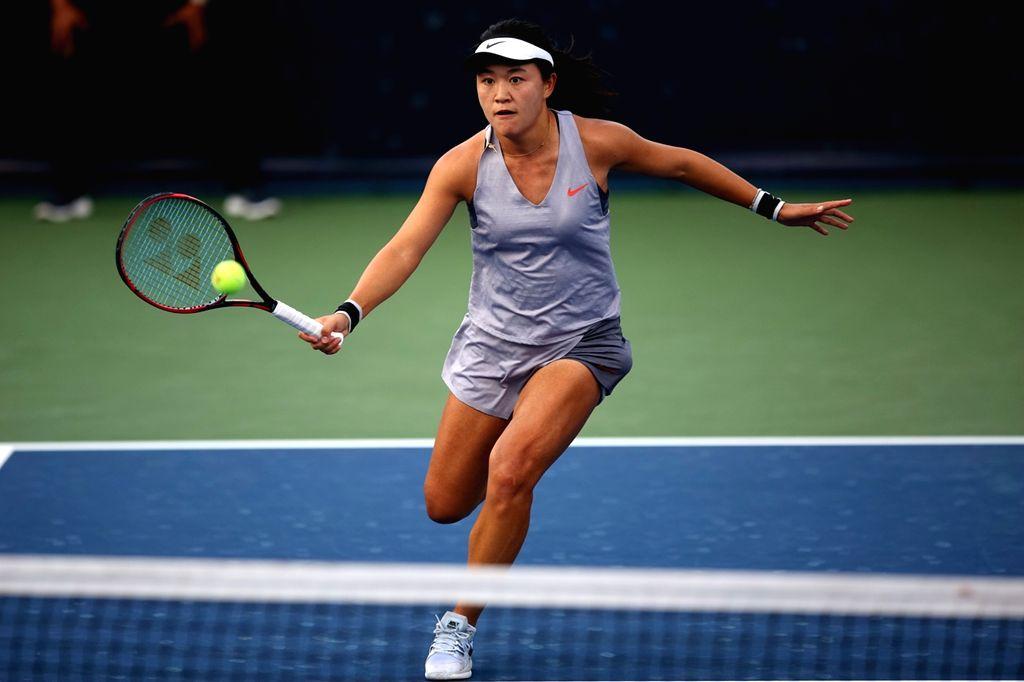 DUBAI, Feb. 19, 2019 - Zhu Lin of China returns the ball during the women's singles second round match against Lesia Tsurenko of Ukraine at Dubai Duty Free Tennis WTA Championships 2019 in Dubai, the ...