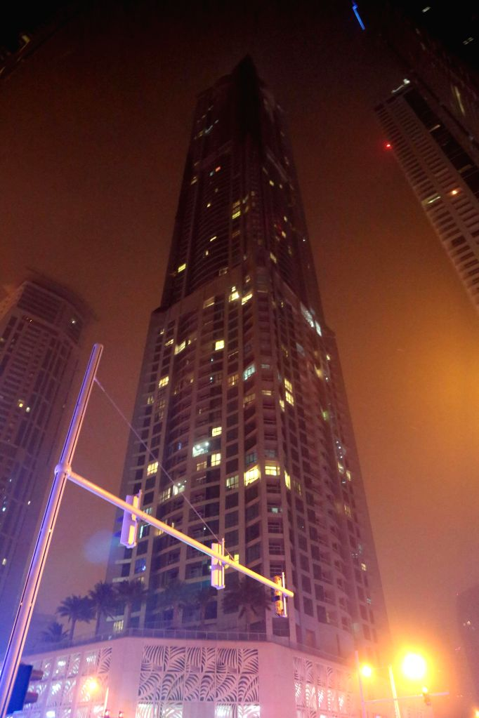 Photo taken on Feb. 21, 2015 shows the Marina Torch which caught fire on early Saturday morning in Dubai, the United Arab Emirates (UAE). The 79-story Marina Torch, ...
