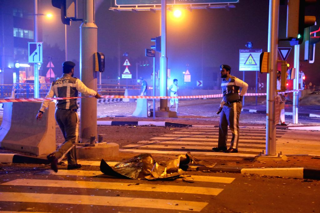 Policemen stand guard at the Marina Torch which caught fire on early Saturday morning in Dubai, the United Arab Emirates (UAE), Feb. 21, 2015. The 79-story Marina ...