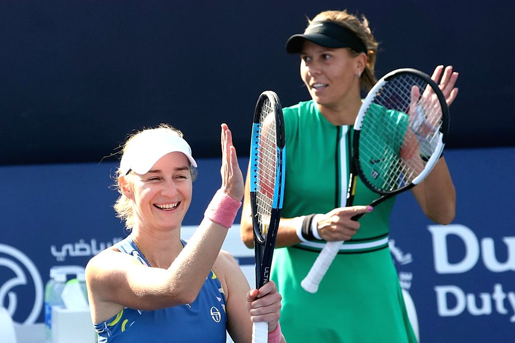 DUBAI, Feb. 21, 2019 - Ekaterina Makarova (L)/Lucie Hradecka celebrate victory after winning the women's doubles quarterfinal match between Gabriela Dabrowski (Canada)/Xu Yifan (China) and Lucie ...