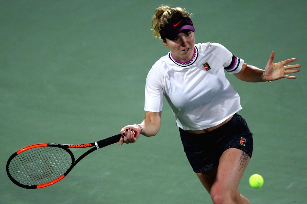 DUBAI, Feb. 22, 2019 - Elina Svitolina of Ukraine returns the ball during the women's singles quarterfinal match against Carla Suarez Navarro of Spain at Dubai Duty Free Tennis WTA Championships 2019 ...