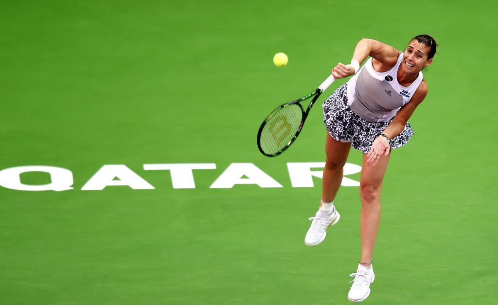 Flavia Pennetta of Italy competes during the women's singles match against Svetlana Kuznetsova of Russia at the 2015 WTA Qatar Open tennis tournament in Doha, Qatar, ...