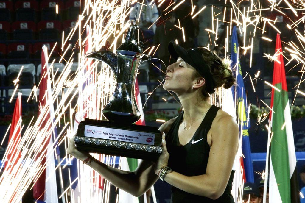 DUBAI-, Feb. 24, 2019 Belinda Bencic of Switzerland kiss the trophy after winning the women's singles final match between Belinda Bencic of Switzerland and Petra Kvitova of the Czech ...