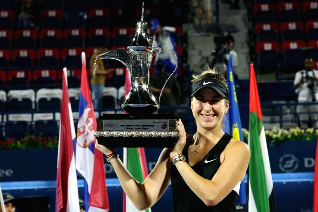 DUBAI-, Feb. 24, 2019 Belinda Bencic of Switzerland poses with the trophy after winning the women's singles final match between Belinda Bencic of Switzerland and Petra Kvitova of the ...