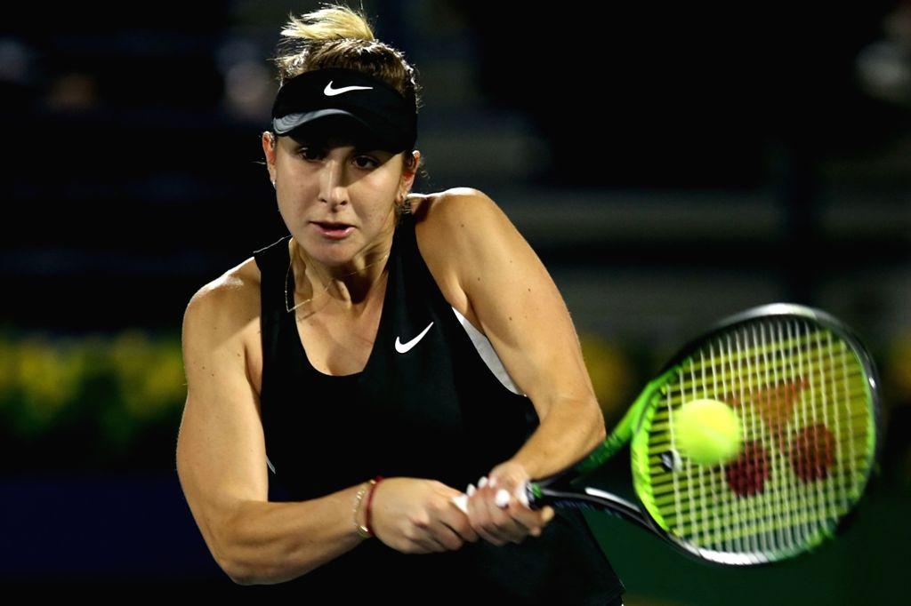 DUBAI-, Feb. 24, 2019 Belinda Bencic of Switzerland returns the shot during the women's singles final match between Belinda Bencic of Switzerland and Petra Kvitova of the Czech Republic ...