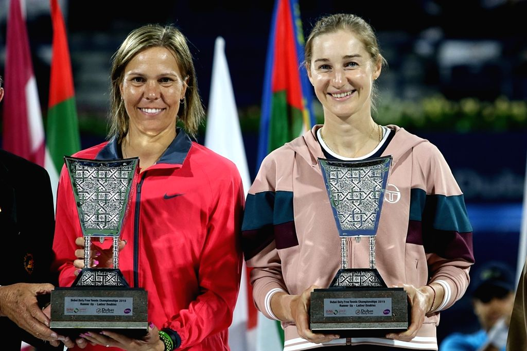 DUBAI, Feb. 24, 2019 - Ekaterina Makarova(R) of Russia/Lucie Hradecka of the Czech Republic pose with the trophy after the women's doubles final match against Hsieh Su-wei of Chinese Taipei/Barbora ...
