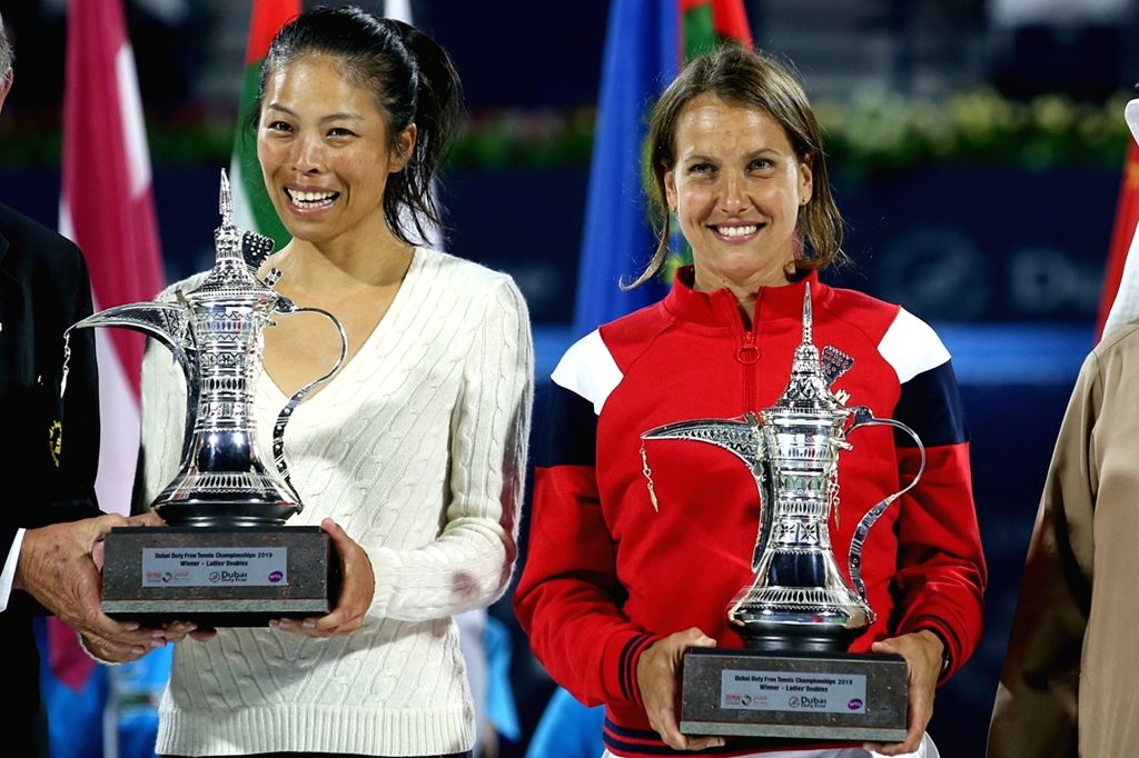 DUBAI, Feb. 24, 2019 - Hsieh Su-wei(L) of Chinese Taipei and Barbora Strycova of the Czech Republic pose with the trophy after winning the women's doubles final match against Ekaterina Makarova of ...