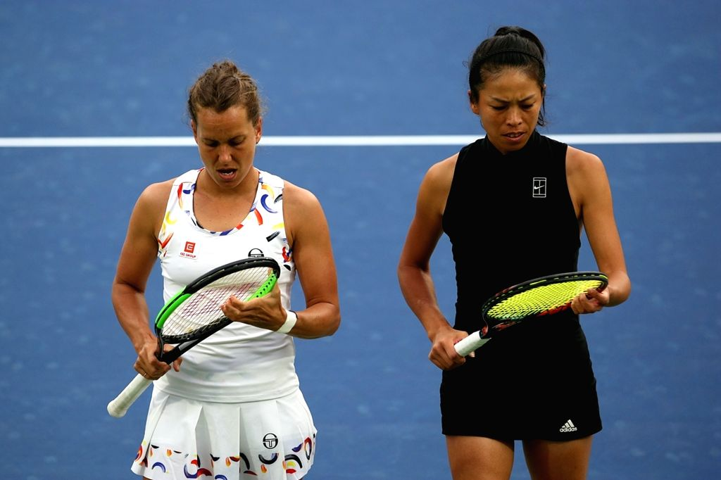 DUBAI, Feb. 24, 2019 - Hsieh Su-wei(R) of Chinese Taipei and Barbora Strycova of the Czech Republic react during the women's doubles final match against Ekaterina Makarova of Russia/Lucie Hradecka of ...