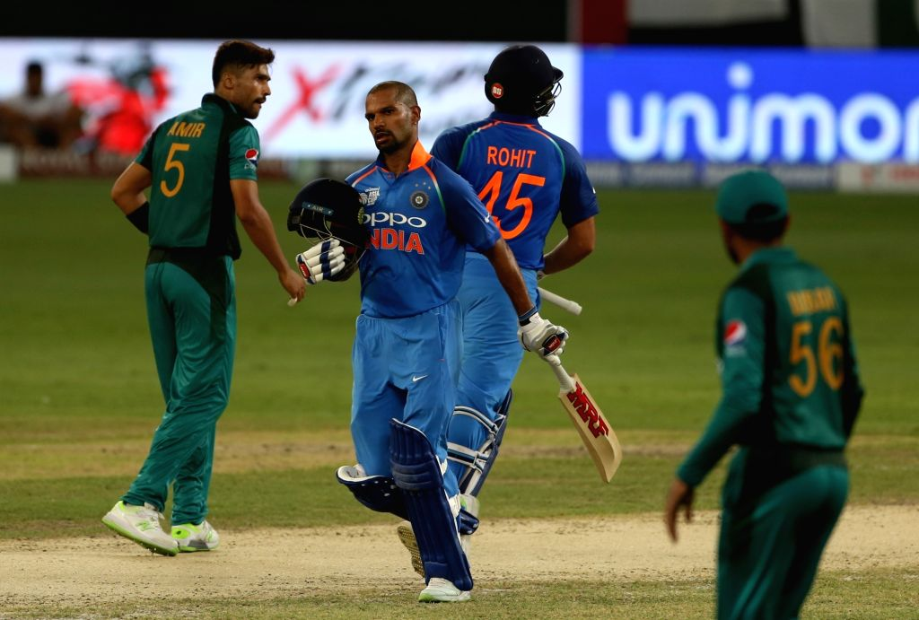 Dubai: India's Shikhar Dhawan and Rohit Sharma during the third match of Asia Cup 2018 Super Four between India and Pakistan at Dubai International Cricket Stadium in UAE on Sept 23, 2018. (Photo: Surjeet Yadav/IANS) - Shikhar Dhawan, Rohit Sharma and Surjeet Yadav