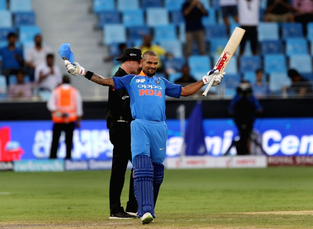 :Dubai: India's Shikhar Dhawan celebrates his century during the fourth match (Group A) of Asia Cup 2018 between Hong Kong and India at Dubai International Cricket Stadium on Sept 18, 2018. ...