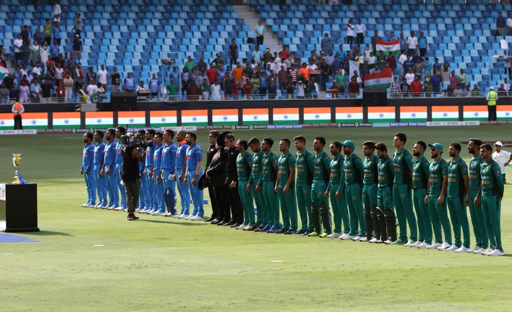 Dubai: Indian and Pakistani players stand during the third match of Asia Cup 2018 Super Four between India and Pakistan at Dubai International Cricket Stadium in Dubai, UAE on Sept 23, 2018. (Photo: Surjeet Yadav/IANS) - Surjeet Yadav
