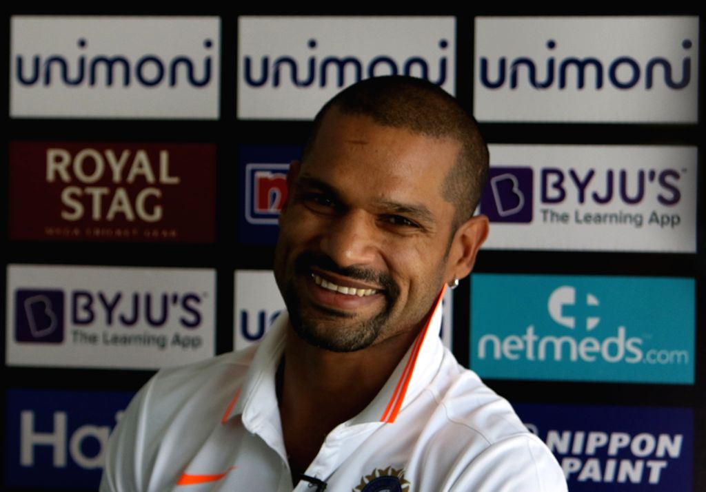 Dubai: Indian cricketer Shikhar Dhawan addresses a press conference on the eve of Asia Cup 2018 final between India and Bangladesh; in Dubai, UAE on Sept 27, 2018. (Photo: Surjeet Yadav/IANS) - Shikhar Dhawan and Surjeet Yadav