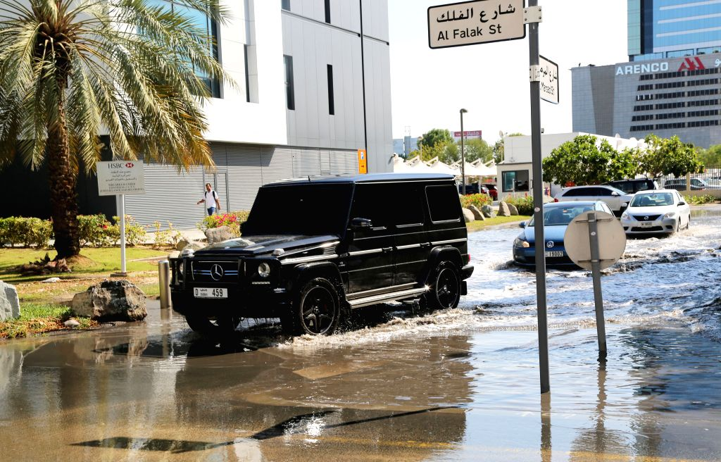 Vehicles move through the water-logged road in Dubai, United Arab Emirates, Jan. 20, 2015. An infrequent rainfall lashed the UAE on Monday, causing waterlogging and ..