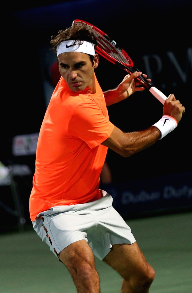 Roger Federer of Switzerland returns the ball to Novak Djokovic of Serbia during their final match on the fifth day of the ATP Dubai Duty Free Tennis Championships on ...