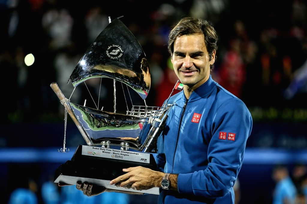 DUBAI, March 3, 2019 - Roger Federer of Switzerland poses with the trophy after winning the singles final match between Roger Federer of Switzerland and Stefanos Tsitsipas of Greece at the ATP Dubai ...