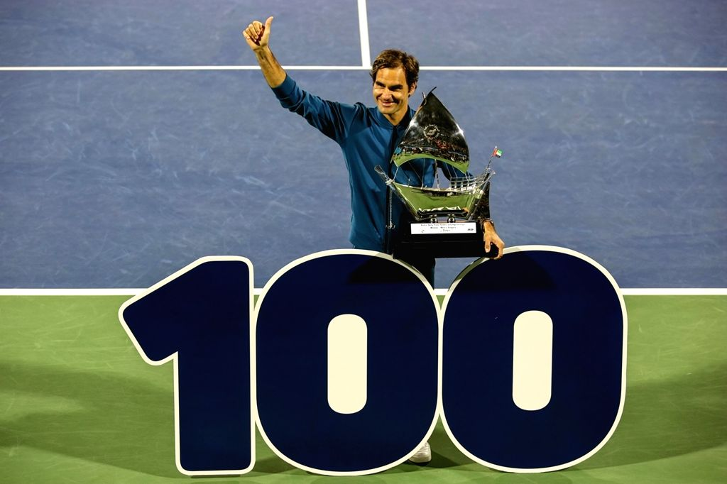 DUBAI, March 3, 2019 - Roger Federer of Switzerland celebrates his 100th career title after winning the singles final match between Roger Federer of Switzerland and Stefanos Tsitsipas of Greece at ...