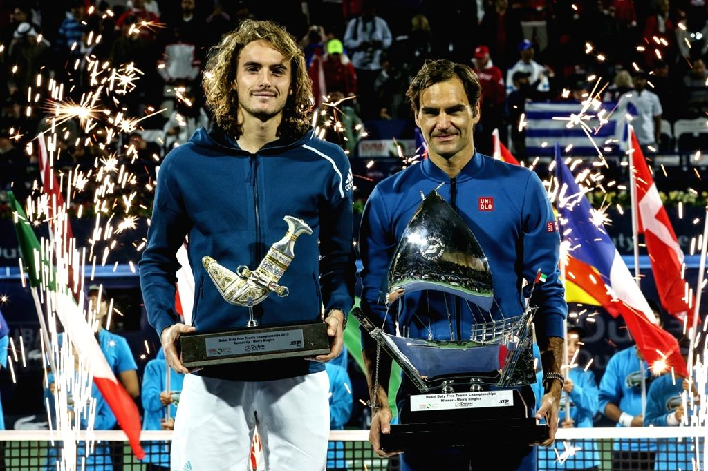 DUBAI, March 3, 2019 - Roger Federer (R) of Switzerland and Stefanos Tsitsipas of Greece pose during the awarding ceremony after the singles final match between Roger Federer of Switzerland and ...