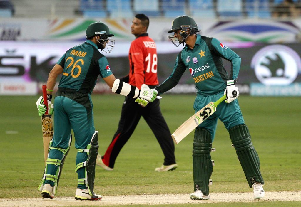 :Dubai: Pakistan's Imam-ul-Haq celebrates his half century during the second match (Group A) of Asia Cup 2018 between Hong Kong and Pakistan at Dubai International Cricket Stadium on Sept 16, ...