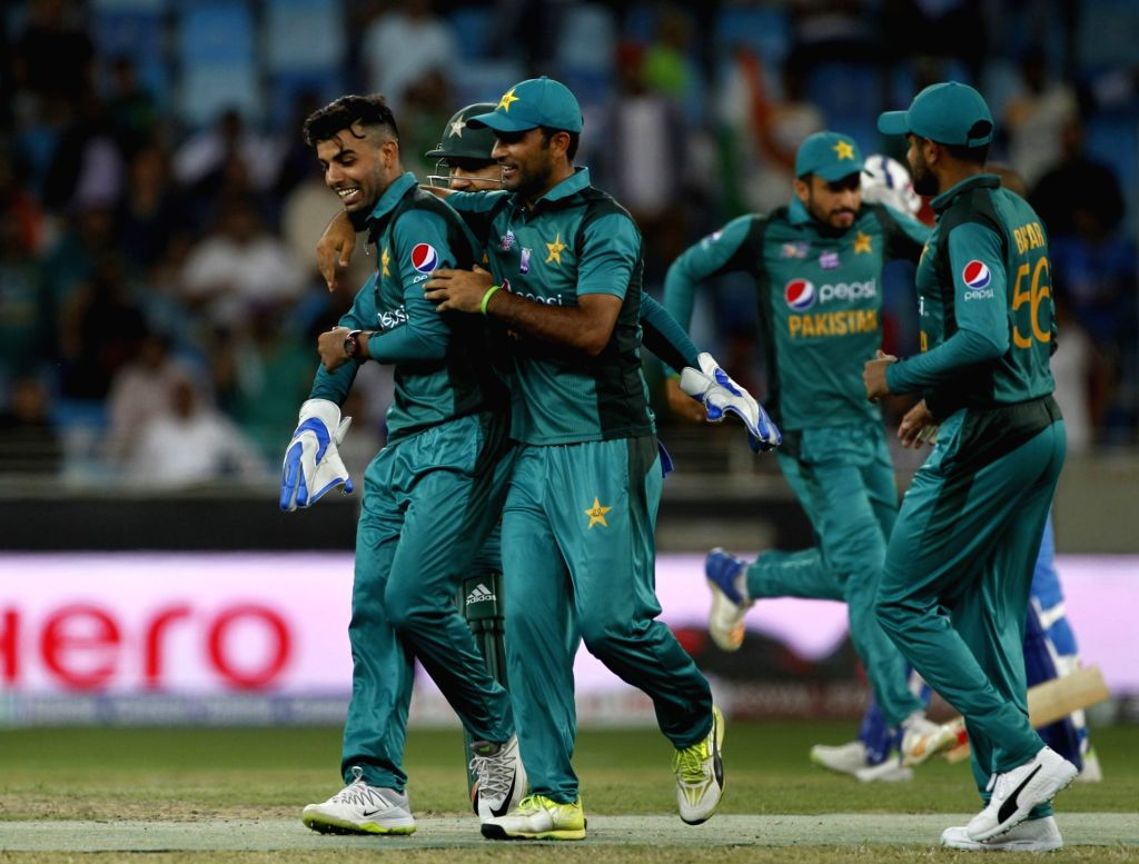 Dubai: Pakistan's Shadab Khan celebrates fall of Rohit Sharma's wicket during the fifth match (Group A) of Asia Cup 2018 between India and Pakistan at Dubai International Cricket Stadium on Sept 19, 2018. (Photo: Surjeet Yadav/IANS) - Shadab Khan, Rohit Sharma and Surjeet Yadav