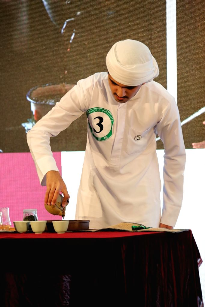 DUBAI, Sept. 21, 2019 - A student performs the art of tea-making during the United Arab Emirates(UAE) final of the 12th Chinese Bridge Chinese Proficiency Competition for Foreign Secondary School ...
