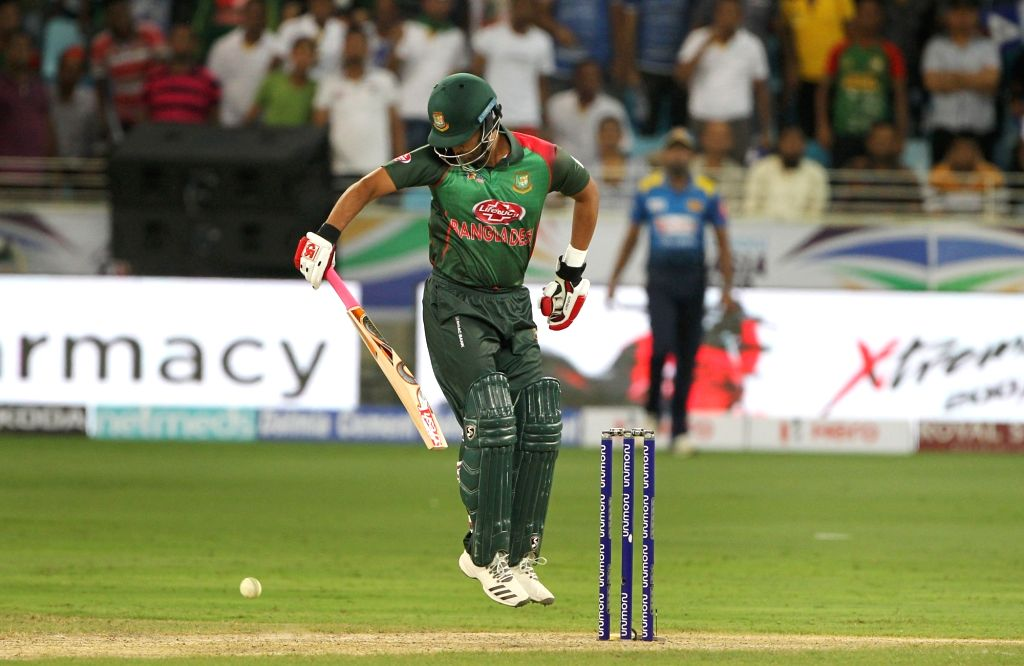 Dubai: Tamim Iqbal of Bangladesh plays with one hand after fracturing his left wrist during Asia Cup 2018 Group B match between Bangladesh and Sri Lanka at Dubai International Cricket Stadium in Dubai, UAE on Sept 15, 2018. Tamim Iqbal has been ruled - Surjeet Yadav