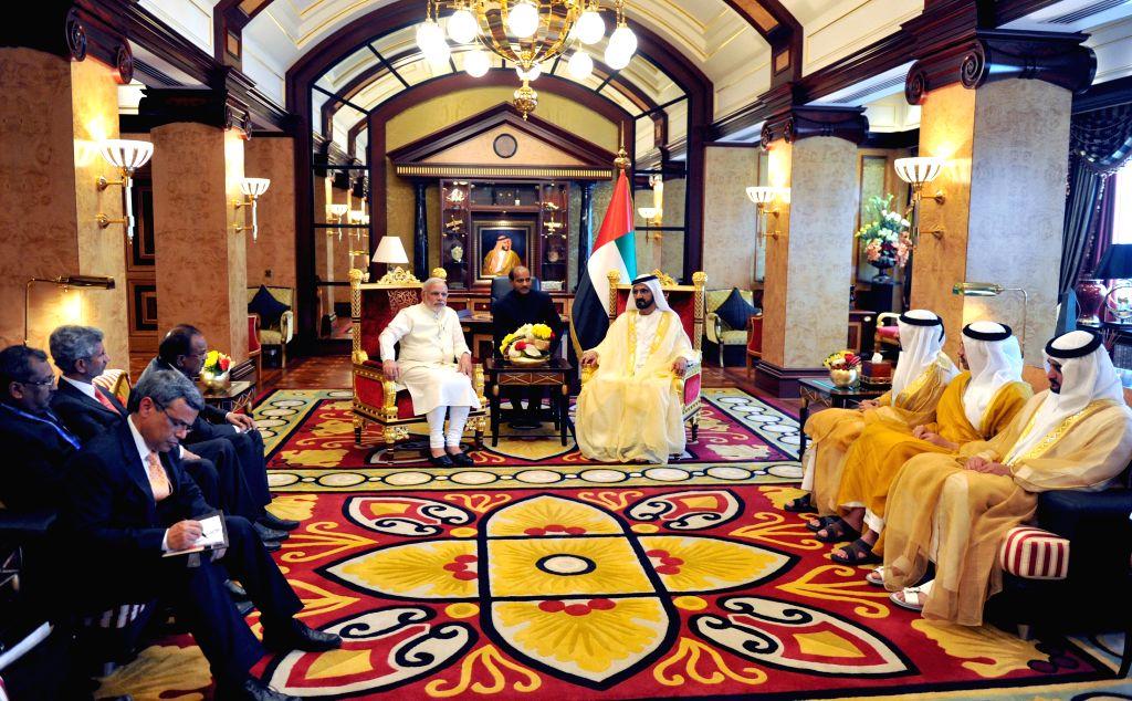 Dubai (UAE): Prime Minister Narendra Modi meets the Vice-President and Prime Minister of UAE, HH Mohammed bin Rashid Al Maktoum, at Za'abeel Palace, Dubai on Aug 17, 2015. - Narendra Modi