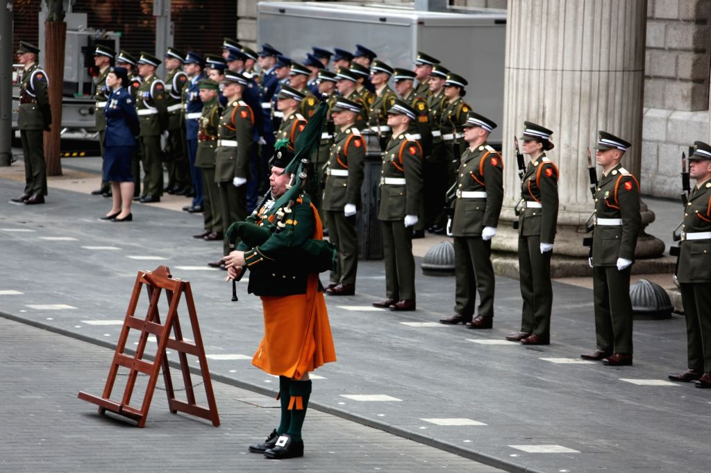 DUBLIN, April 2, 2018 - A piper performs at a ceremony to mark Easter Rising in Dublin, capital of Ireland, April 1, 2018. A ceremony was held in front of the General Post Office building in Dublin ...