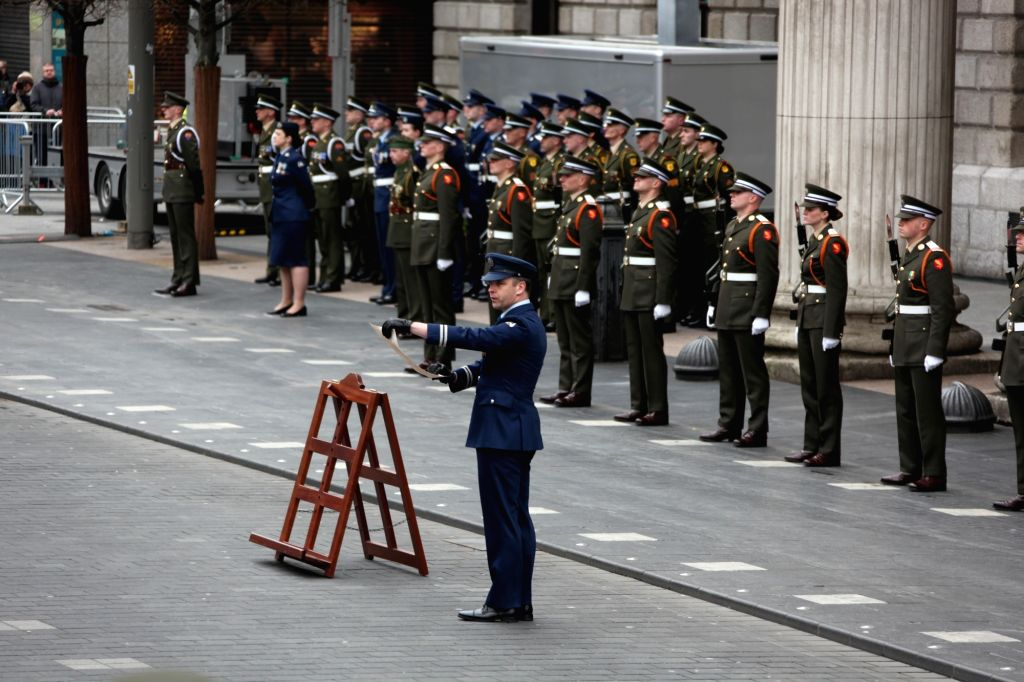 DUBLIN, April 2, 2018 - An army officer reads Proclamation at a ceremony to mark Easter Rising in Dublin, capital of Ireland, April 1, 2018. A ceremony was held in front of the General Post Office ...