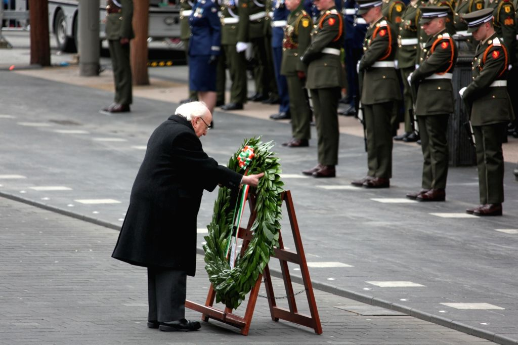 DUBLIN, April 2, 2018 - Irish President Michael Higgins lays a wreath at a ceremony to mark Easter Rising in Dublin, capital of Ireland, April 1, 2018. A ceremony was held in front of the General ...