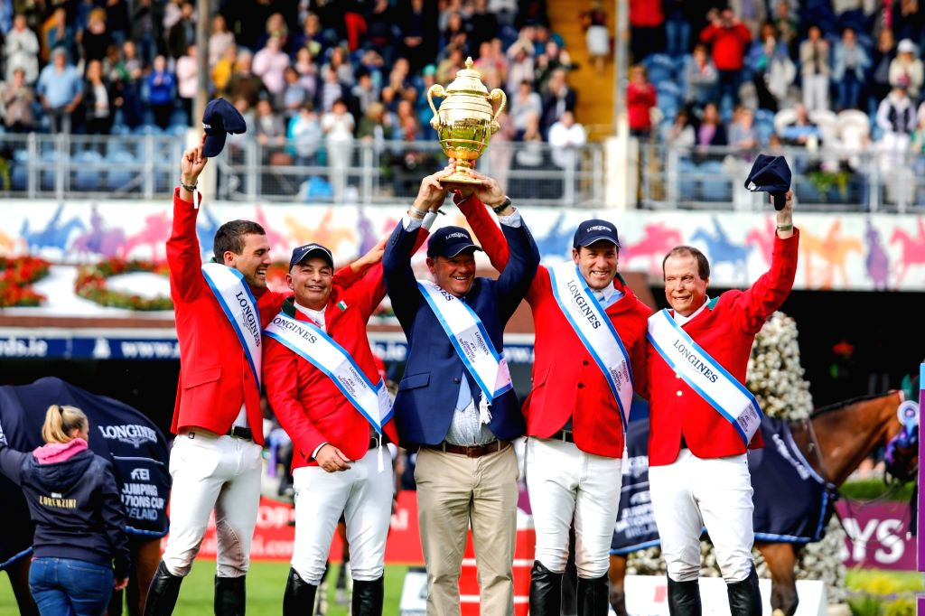 DUBLIN, Aug. 11, 2018 - Mexican team members celebrate after winning the trophy of FEI Jumping Nations Cup of Ireland in Dublin, Ireland, Aug. 10, 2018. Mexico stunned their European rivals by ...