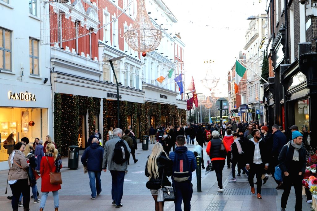 DUBLIN, Dec. 4, 2018 - A shop decorated with Christmas trees and lights are seen on a street in downtown Dublin, Ireland, Dec. 3, 2018. Irish households will spend an average of 2,690 euros (3,050 ...