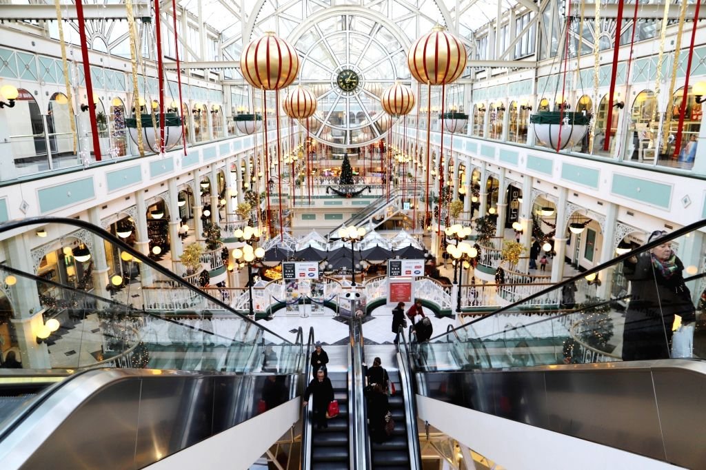 DUBLIN, Dec. 4, 2018 - People are seen inside a shopping center decorated with Christmas trees and lights in downtown Dublin, Ireland, Dec. 3, 2018. Irish households will spend an average of 2,690 ...