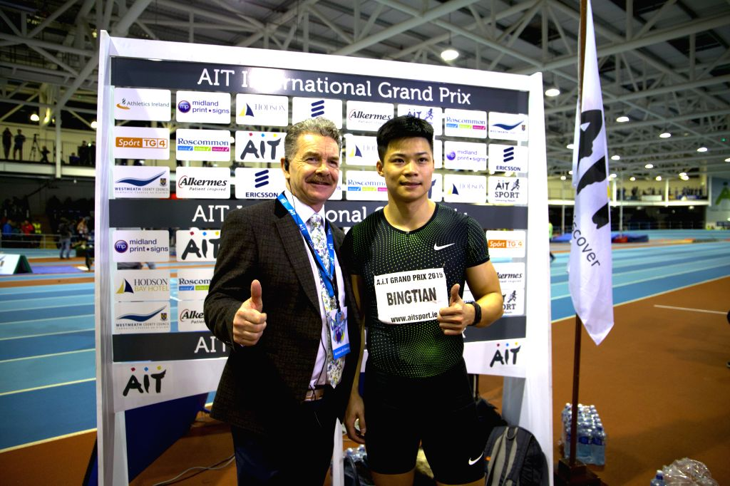 DUBLIN, Feb. 14, 2019 - Su Bingtian (R) of China poses after he won the men's 60m final event at AIT International Indoor Grand Prix 2019 in Athlone, central Ireland, Feb. 13, 2019. Su Bingtian of ...