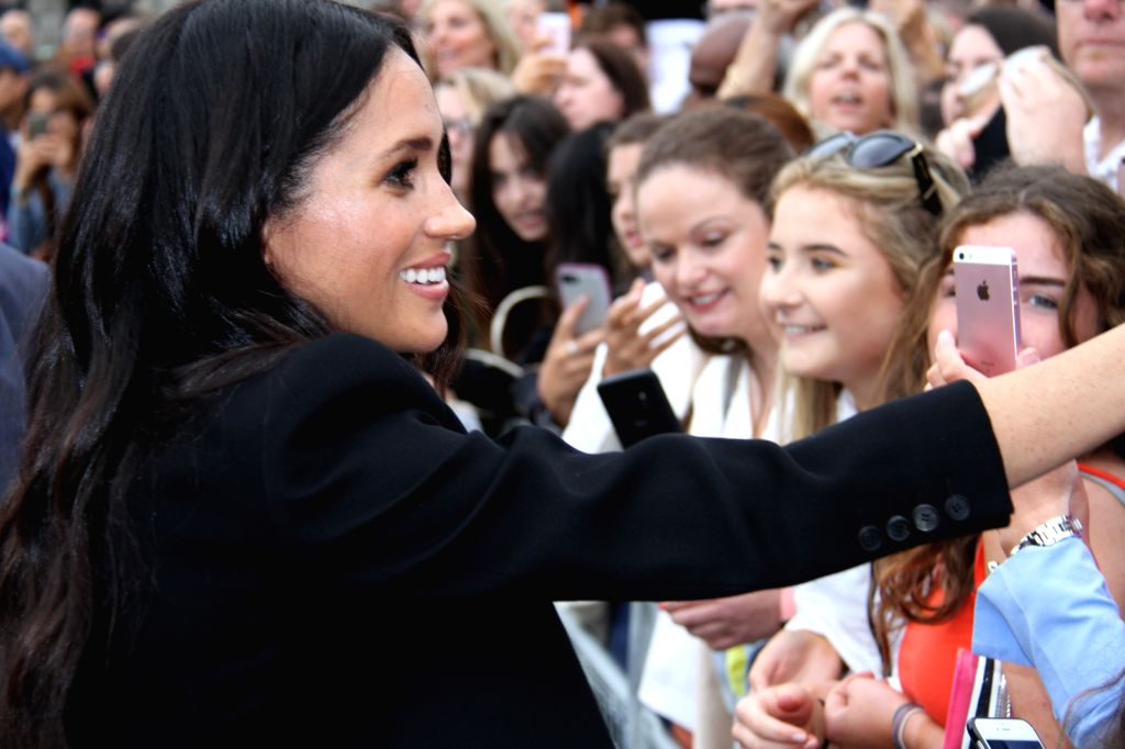 DUBLIN, July 12, 2018 (Xinhua) -- Meghan Markle, wife of Britain's Prince Harry, meets with the public at the Trinity College Dublin in Dublin, Ireland, July 11, 2018. Britain's Prince Harry and his wife Meghan Markle on Wednesday wrapped up a two-da