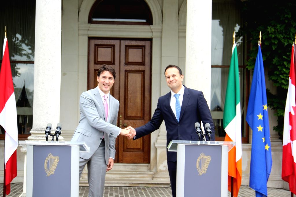 DUBLIN, July 5, 2017 - Canadian Prime Minister Justin Trudeau (L) shakes hands with Irish Prime Minister Leo Varadkar in Dublin, Ireland, July 4, 2017. Irish Taoiseach (Prime Minister) Leo Varadkar ... - Justin Trudeau