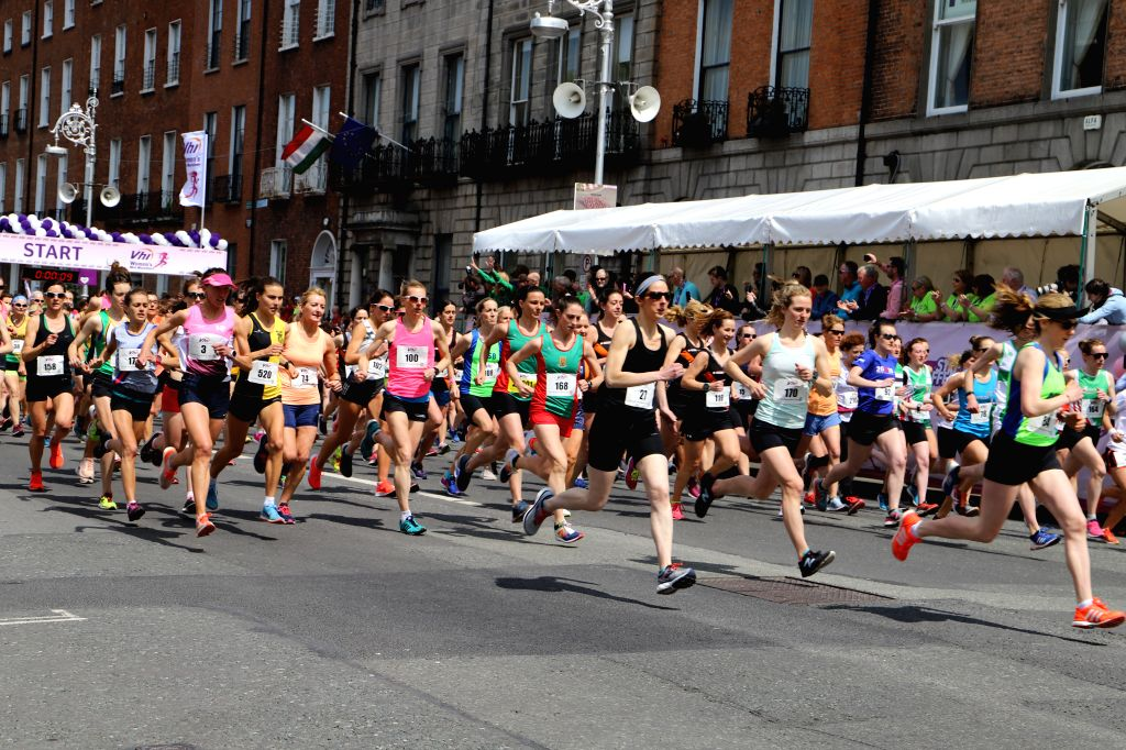 DUBLIN, June 3, 2019 - Participants take part in a women's 10-km mini marathon in Dublin, Ireland, June 2, 2019. The annual event was designed to promote a healthy lifestyle for women of all ages in ...
