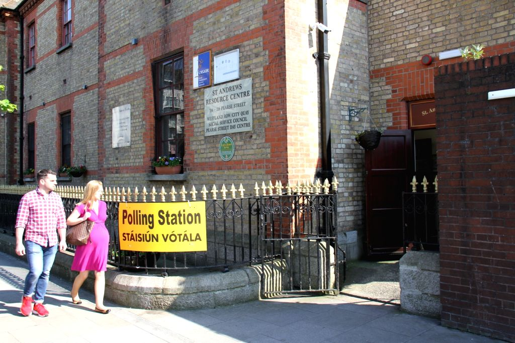 DUBLIN, May 26, 2018 - A couple enter a polling station in Dublin, Ireland, May 25, 2018. Nearly 70 percent of Irish voted to abolish Ireland's longtime abortion ban in a Friday referendum, according ...