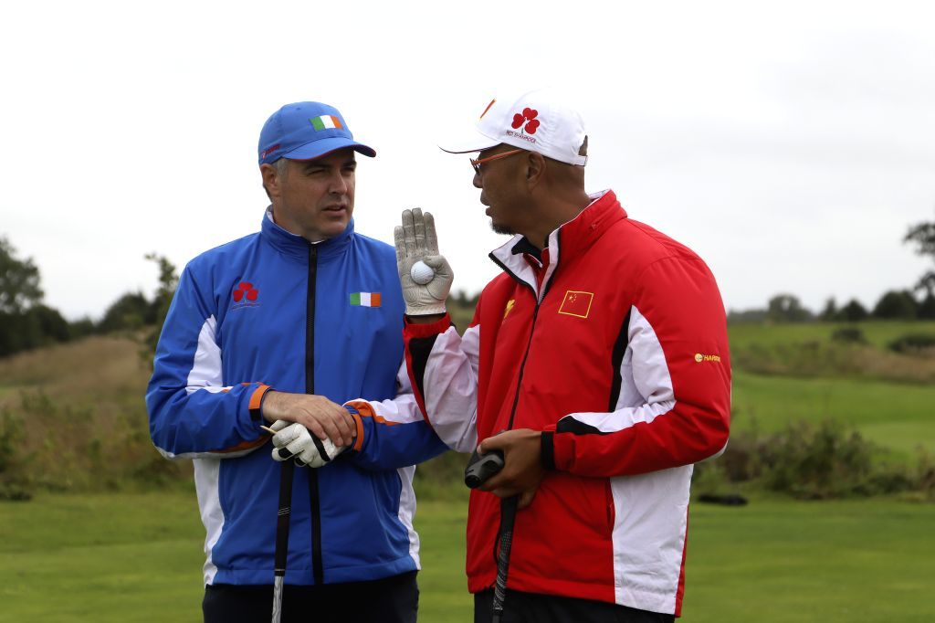 """DUBLIN, Sept. 11, 2018 - A Chinese golf player (R) interacts with his Irish counterpart on the third day of the """"Harris Cup Ireland-China Amateur Tournament"""" at a golf club in County ..."""
