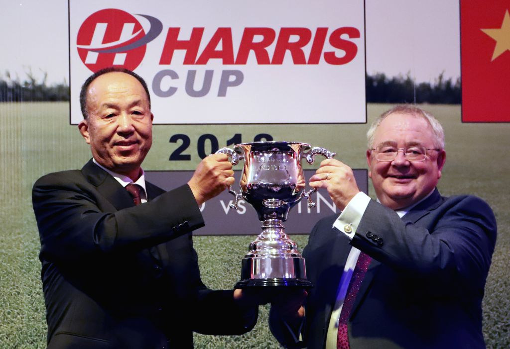 DUBLIN, Sept. 11, 2018 - Sean O'Fearghail (R), chairperson of the lower house of the Irish parliament, awards a trophy to a representative of a Chinese golf team at a golf club in County Kildare, ...