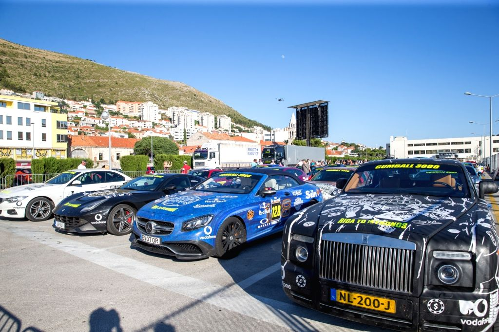 DUBROVNIK, July 5, 2017 - Gumball 3000 rally drivers display their vehicles in Dubrovnik, Croatia, on July 4, 2017. The rally is an annual luxury automotive road trip travelling a different 4,800km ...