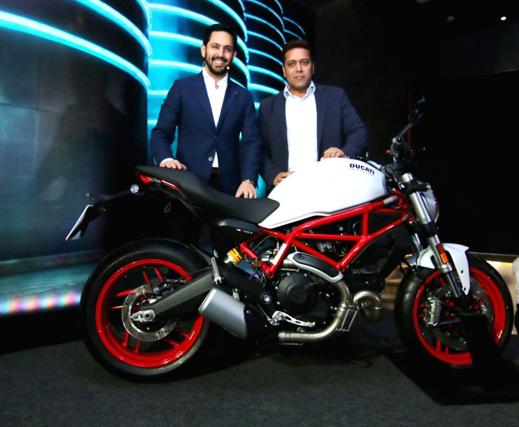"""Ducati India MD Ravi Avalur with Ducati India Director of Operations Yogesh Phogat (L-R) unveils """"Ducati Monster 797"""" in New Delhi, on June 14, 2017."""