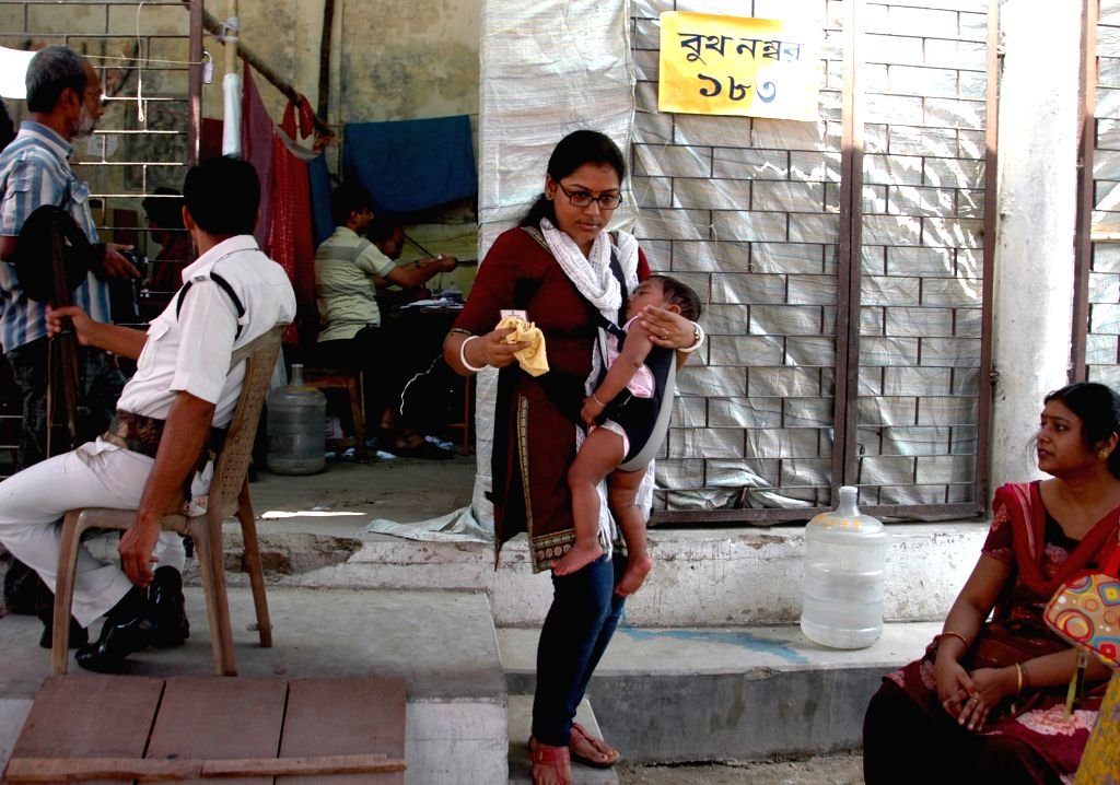 Dum Dum: A woman comes out after casting her vote during South Dum Dum Municipality Polls in North 24 Parganas of West Bengal on April 25, 2015.