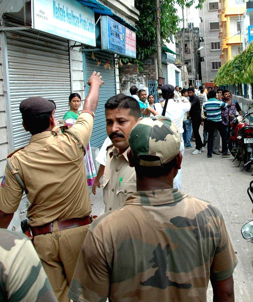 Dum Dum: Policemen deployed during  South Dum Dum Municipality Polls in North 24 Parganas of West Bengal on April 25, 2015.