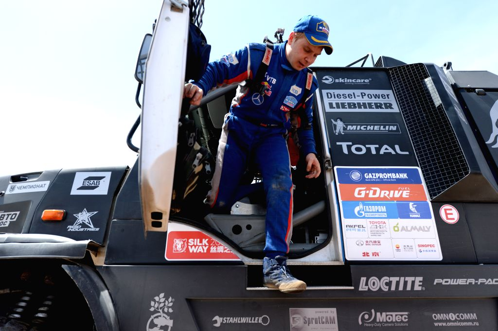 DUNHUANG, July 19, 2016 - KAMAZ MASTER's driver Eduard Nikolaev gets off the truck after the 10th special stage of the Silkway Rally in Dunhuang, northwest China's Gansu Province, on July 19, 2016.