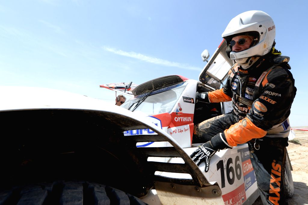 DUNHUANG, July 19, 2016 - MD RALLYE SPORT's driver Cornelis Koolen takes off the car after the 10th special stage of the Silkway Rally in Dunhuang, northwest China's Gansu Province, on July 19, 2016.