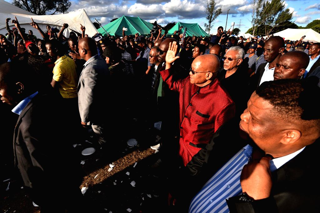 South Africa's President Jacob Zuma (2nd R) visits a camp for displaced foreigners in Chatsworth of Durban, South Africa, on April 18, 2015. President Jacob Zuma ...