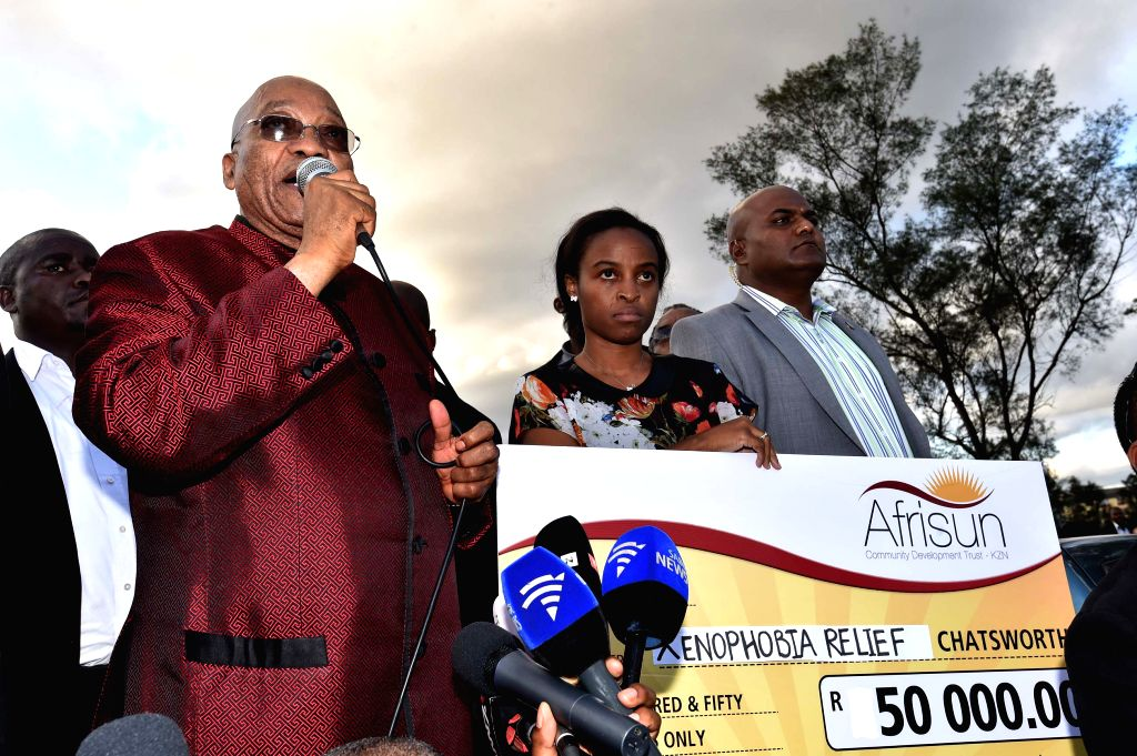 South Africa's President Jacob Zuma (L) speaks at a camp for displaced foreigners in Chatsworth of Durban, South Africa, on April 18, 2015. President Jacob Zuma ...