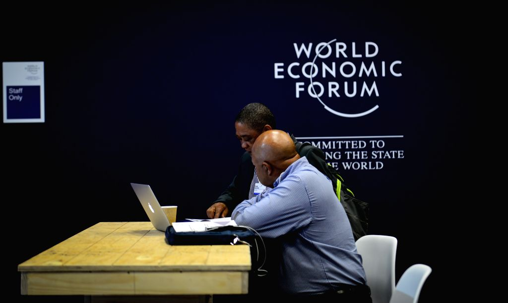DURBAN, May 3, 2017 - Two delegates chat with each other during the opening day of the World Economic Forum on Africa in Durban, South?Africa, on May 3, 2017. The three-day World Economic Forum on ...