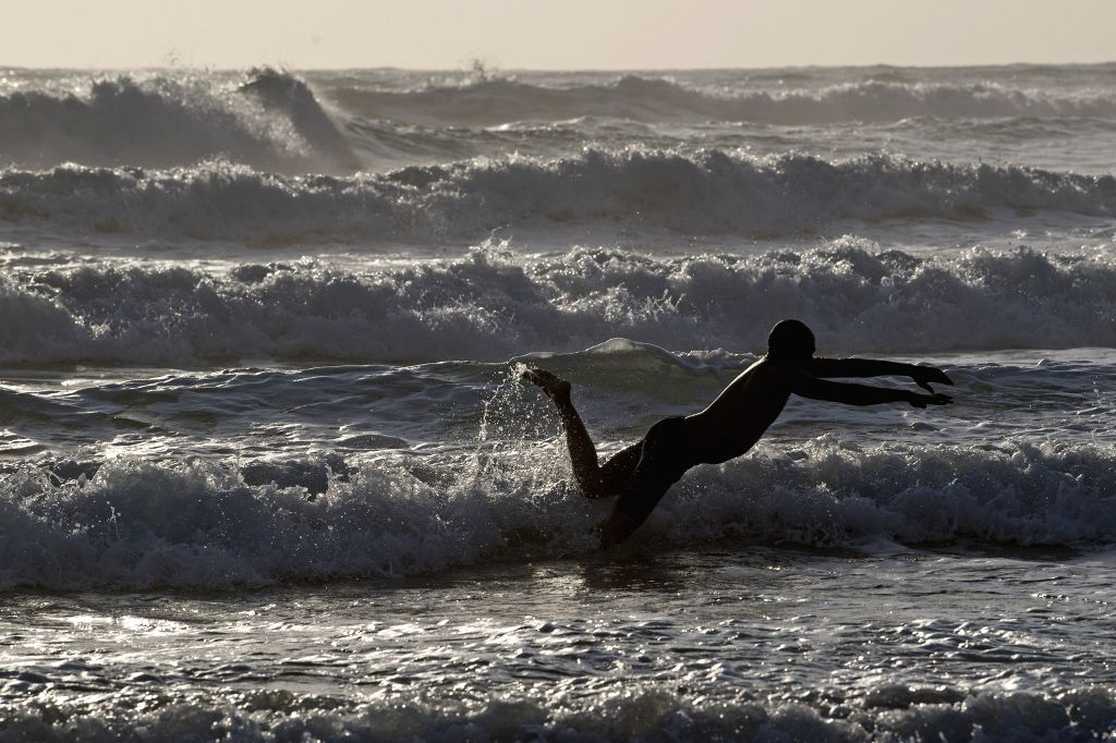 DURBAN, Oct. 18, 2019 - A citizen swims in the sea in Durban, South Africa, Oct. 18, 2019.